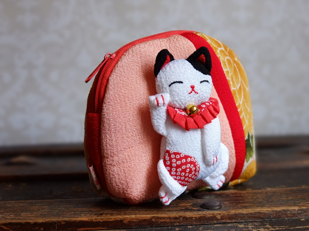 Japan Kyoto silk pouch lucky cat from craft shop in Arashiyama souvenir shopping