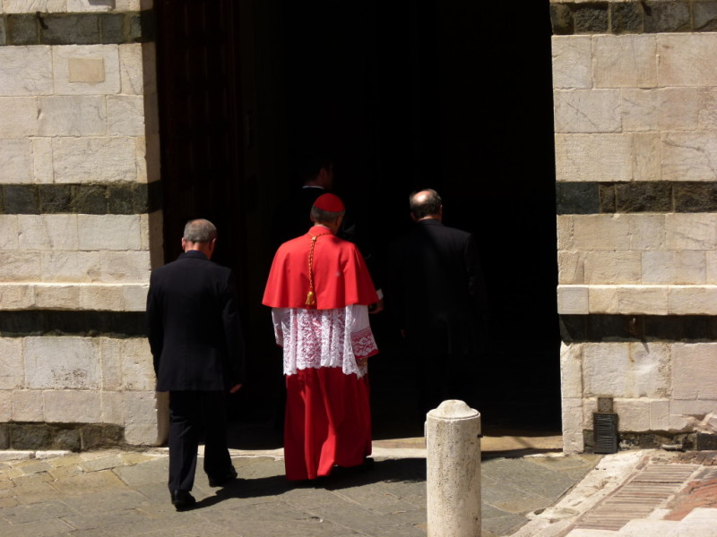 cardinal walking shopping siena tuscany italy souvenirs contrada