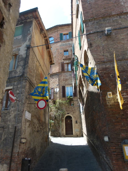 Siena italy tuscany souvenir shopping walking contrada flag streets