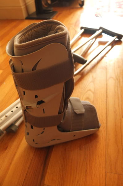 plastic boot and crutches