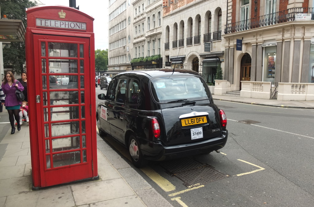 red telephone box and black cab london
