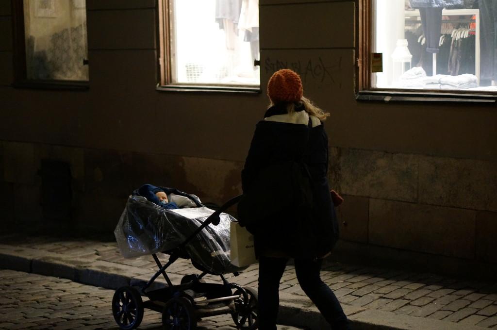 Gamla Stan Stockholm cobblestone street night walking baby