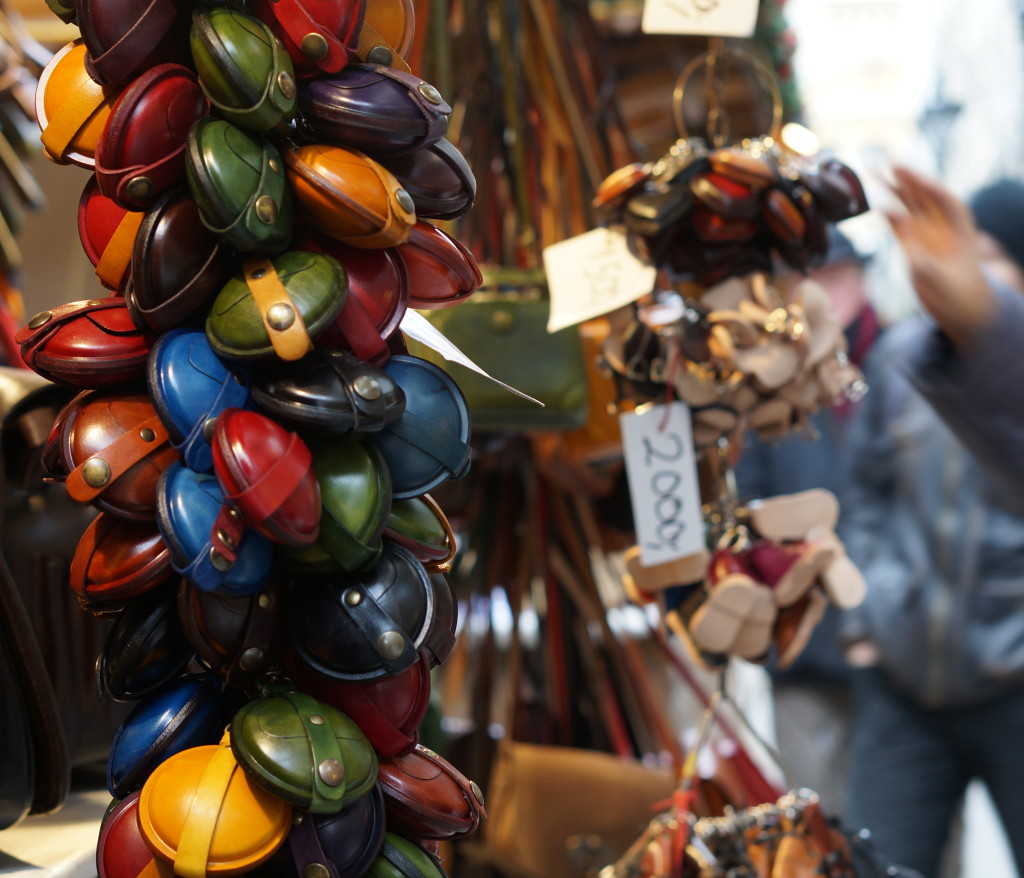 budapest christmas market souvenir hungarian  handmade craft fair leather change purses in a slew of colors.