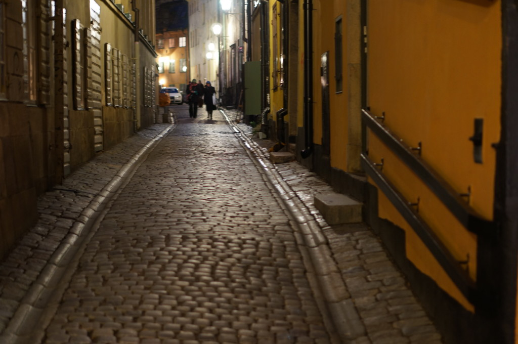 cobblestone street gamla stan at night in stockholm Sweden