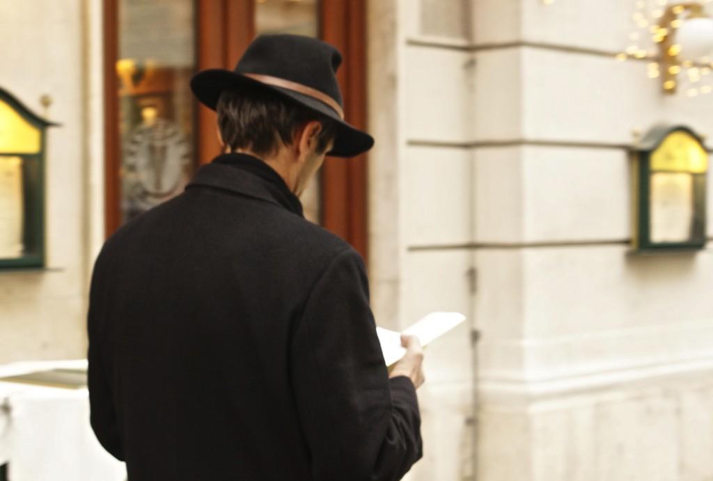viennese men wearing apline hat distracted walking