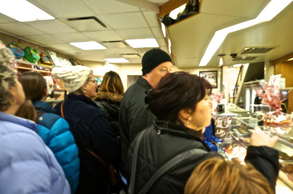 crowd inside carlo's bake shop cake boss