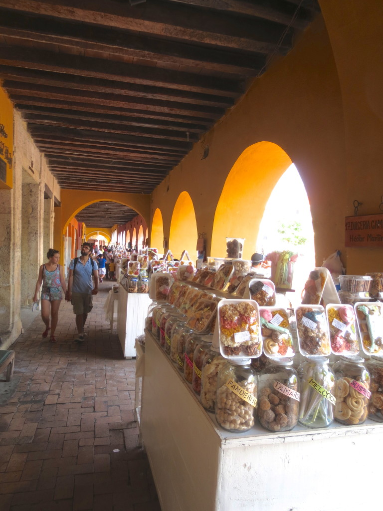 "Cartagena's ""Portal de los Dolces"" - a long narrow aisle full of sweets vendors."