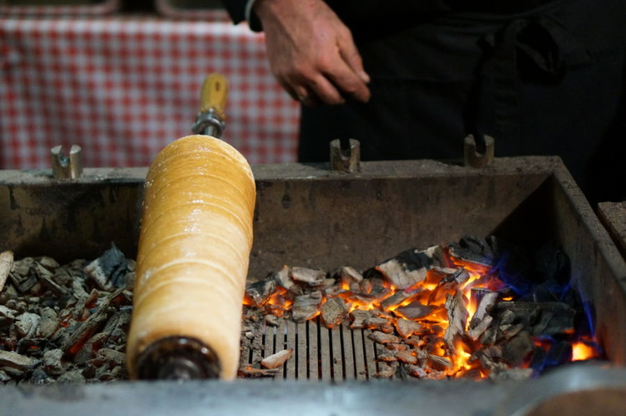 A real chimney cake is mixed and rolled to order, then cooked over hot coals and finished with cinammon sugar.