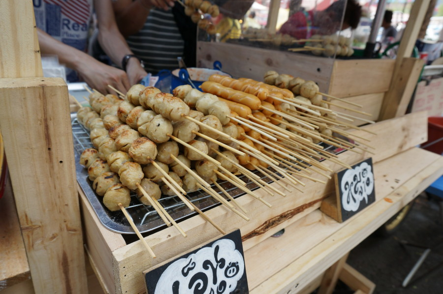 look chin (beef, chicken and pork balls on a stick) at Chatuchak market JJ market Bangkok Thailand street vendor