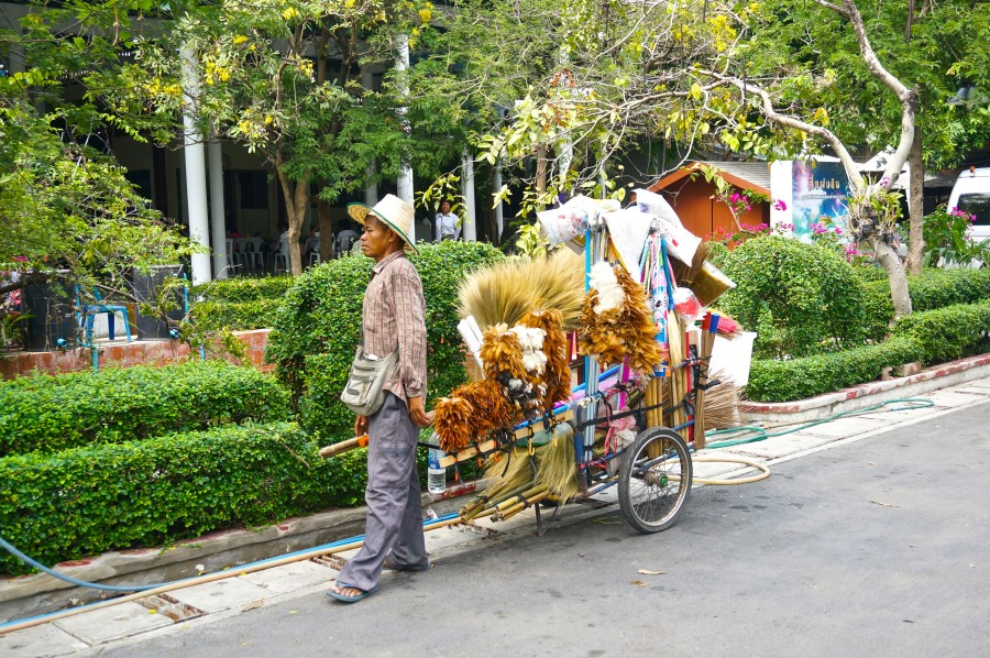 thai broom vendor street cart