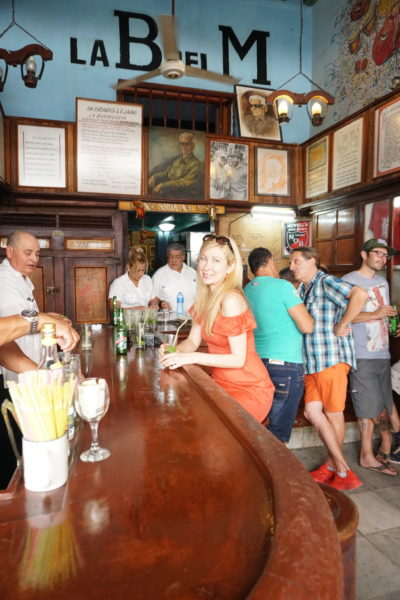 off shoulder red dress hemingway Hemingway's favorite mojito bar, La Bodeguita del Medio old Havana Cuba