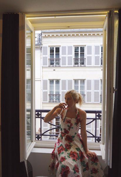 drinking champagne in paris french windows doors
