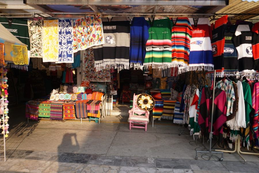 Shopping for souvenirs at the colorful La Ciudadela market in Mexico City. photos